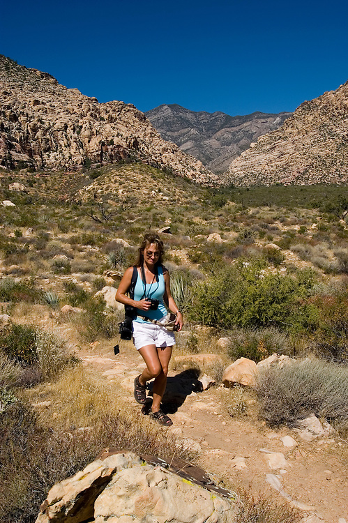 Woman hiking at Willow Springs Trail in Red Rock State Park near Las Vegas, Nevada, NV, woman hiker, model released, hiking, hiking path, image nv402-18446  .Photo copyright: Lee Foster, www.fostertravel.com, lee@fostertravel.com, 510-549-2202