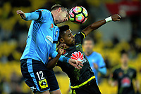Aaron Calver beats Roy Krishna to a header during the A-League football match between Wellington Phoenix and Sydney FC at Westpac Stadium in Wellington, New Zealand on Saturday, 8 April 2017. Photo: Dave Lintott / lintottphoto.co.nz
