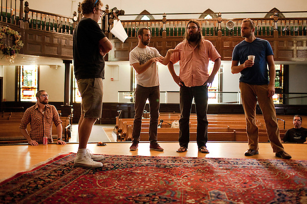 September 14, 2010.  Durham, North Carolina.. Pinson Chanselle, Phil Cook, Bryan, Matt White and Cameron Ralston discuss the set up plan for the stage.. Day One of Sounds of the South, a reinterpretation of Alan Lomax's field recordings, with music by Megafaun, Fight the Big Bull, Sharon Van Etten and Justin Vernon of Bon Iver..