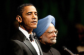Washington, DC - November 24, 2009 -- United States President Barack Obama, left, and Manmohan Singh, India's prime minister, speak during the State Dinner on the South Lawn of the White House in Washington, D.C., U.S., on Tuesday, Nov. 24, 2009. Obama welcomed India's role as a rising and responsible global power, saying the U.S. will follow through on a civilian nuclear agreement and work to expand trade and investment ties with the world's largest democracy. .Credit: Andrew Harrer - Pool via CNP