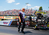 Jun 8, 2019; Topeka, KS, USA; Todd Haas, crew member for NHRA top fuel driver Scott Palmer during qualifying for the Heartland Nationals at Heartland Motorsports Park. Mandatory Credit: Mark J. Rebilas-USA TODAY Sports