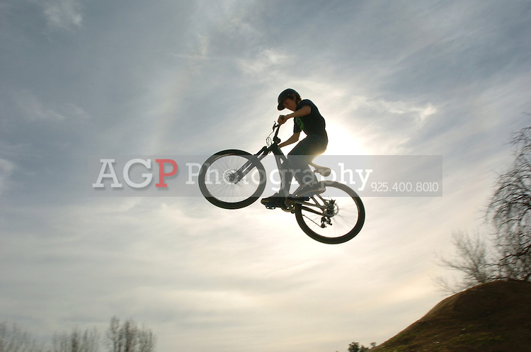 A rider gets some air at the BMX Track in Pleasanton, California Saturday January 20th 2006. (Photo by Alan Greth)