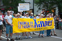 Catholic Church of St. Francis Xavier contingent in  the 43rd annual Lesbian, Gay, Bisexual and Transgender Pride Parade on Fifth Avenue in New York on Sunday, June 24, 2012. The parade took place on the one year anniversary of the legalization of gay marriage in New York.  (© Richard B. Levine)