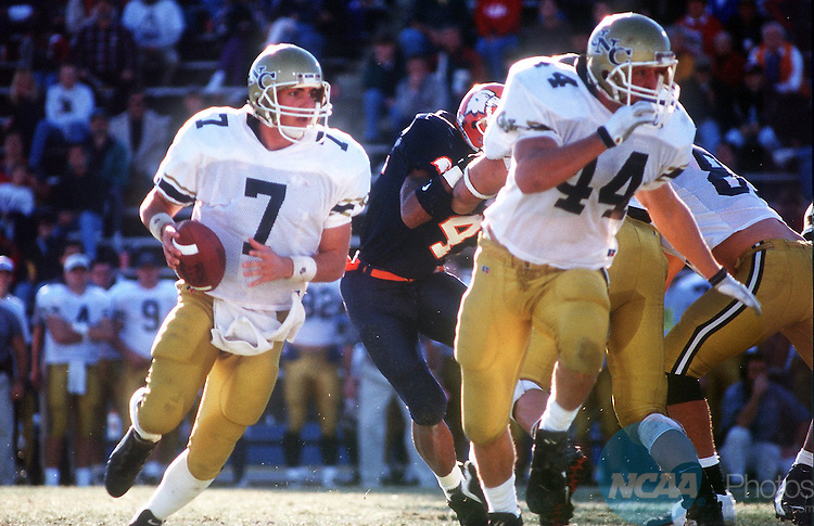 Caption: 14 Dec 1996: University of Northern Colorado quarter-back Tom Beck (7) follows full-back Mark Chicarelli (44) for cover while looking for a pass during the Division 2 Men's Football Championship hosted by the University of North Alabama at Braly Municipal Stadium in Florence, AL... Northern Colorado defeated Carson-Newman 23-14 for the championship title. Josh Gibson/NCAA Photos.