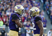 Keishawn Bierria and Lavon Coleman (22) get fired up after a big play on special teams.
