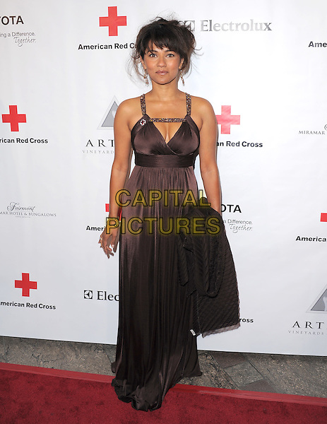 SULEKA MATHEW.At The American Red Cross, Santa Monica Chapter's Annual Red Tie Affair held at The Fairmont Miramar Hotel & Bungalows in Santa Monica, California, USA, April 9th 2011..full length long maxi dress  pleated  brown cleavage straps .CAP/RKE/DVS.©DVS/RockinExposures/Capital Pictures.