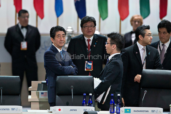 Shinzo Abe, Japan's prime minister, left, waits to begin an opening plenary entitled &quot;National Actions to Enhance Nuclear Security&quot;at the Nuclear Security Summit in Washington, D.C., U.S., on Friday, April 1, 2016. After a spate of terrorist attacks from Europe to Africa, U.S. President Barack  Obama is rallying international support during the summit for an effort to keep Islamic State and similar groups from obtaining nuclear material and other weapons of mass destruction. <br /> Credit: Andrew Harrer / Pool via CNP/MediaPunch
