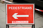 Red arrow pedestrians sign