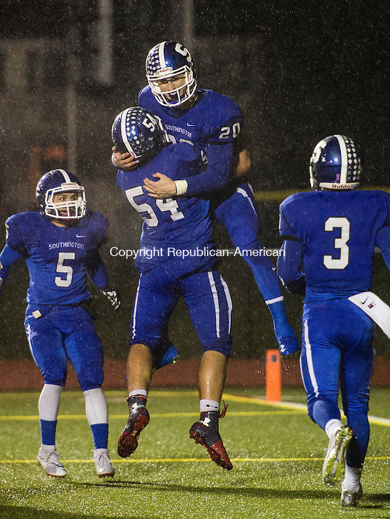 SOUTHINGTON, CT- 1 December 2015-120115EC02-   Southington's Jasen Rose (20) celebrates with (54) Albert Palumbo after Rose makes a touchdown against Conard. The Blue Knights won Tuesday night's home game. Erin Covey Republican-American
