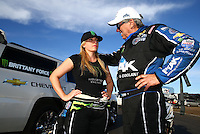 Feb 28, 2016; Chandler, AZ, USA; NHRA funny car driver John Force (right) consoles daughter Brittany Force after both lost in the final round during the Carquest Nationals at Wild Horse Pass Motorsports Park. Mandatory Credit: Mark J. Rebilas-USA TODAY Sports