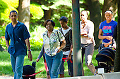 United States President Barack Obama takes a walk down the street near his home in Chicago, Illinois accompanied by his mother-in-law Marian Robinson, his wife Michelle, his daughters Sasha and Malia and the family dog Bo to the home of neighbor and First Pal Marty Nesbitt for a backyard barbecue on Saturday, May 29, 2010..Credit: Ralf-Finn Hestoft  - Pool via CNP