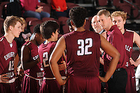 NWA Democrat-Gazette/ANDY SHUPE<br /> Springdale coach Jeremy Price (right) speaks to his team against Tulsa (Okla.) Holland Hall Tuesday. Dec. 29, 2015, during the second half at Siloam Springs High School. Visit nwadg.com/photos to see more photographs from the game.