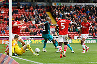Andre Ayew of Swansea City (C) scores the opening goal during the Sky Bet Championship match between Barnsley and Swansea City at Oakwell Stadium, Barnsley, England, UK. Saturday 19 October 2019