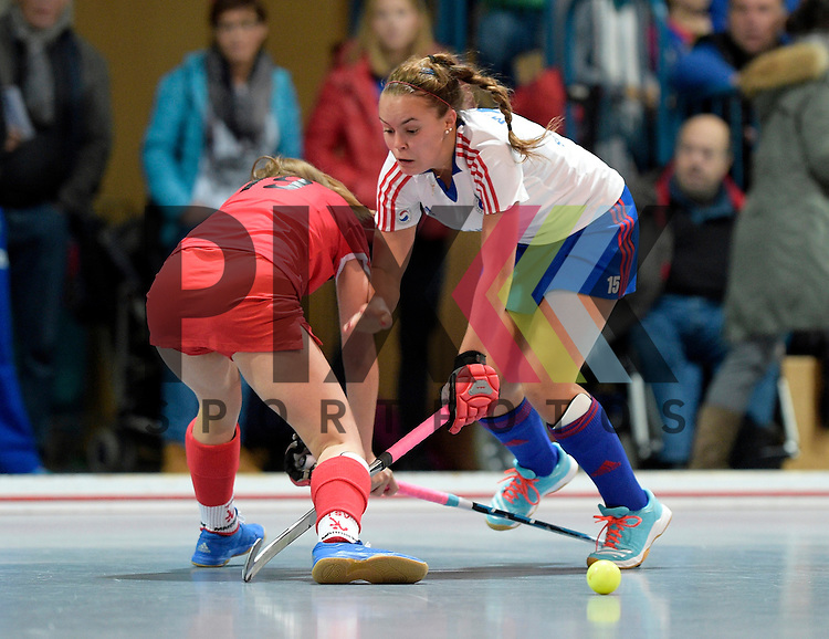GER - Mannheim, Germany, December 05: During the 1. Bundesliga Sued Damen indoor hockey match between Mannheimer HC (white) and TSV Mannheim (red) on December 5, 2015 at Irma-Roechling-Halle in Mannheim, Germany. Final score 7-1 (HT 5-0).  Kira Schanzenbecher #15 of Mannheimer HC<br /> <br /> Foto &copy; PIX-Sportfotos *** Foto ist honorarpflichtig! *** Auf Anfrage in hoeherer Qualitaet/Aufloesung. Belegexemplar erbeten. Veroeffentlichung ausschliesslich fuer journalistisch-publizistische Zwecke. For editorial use only.