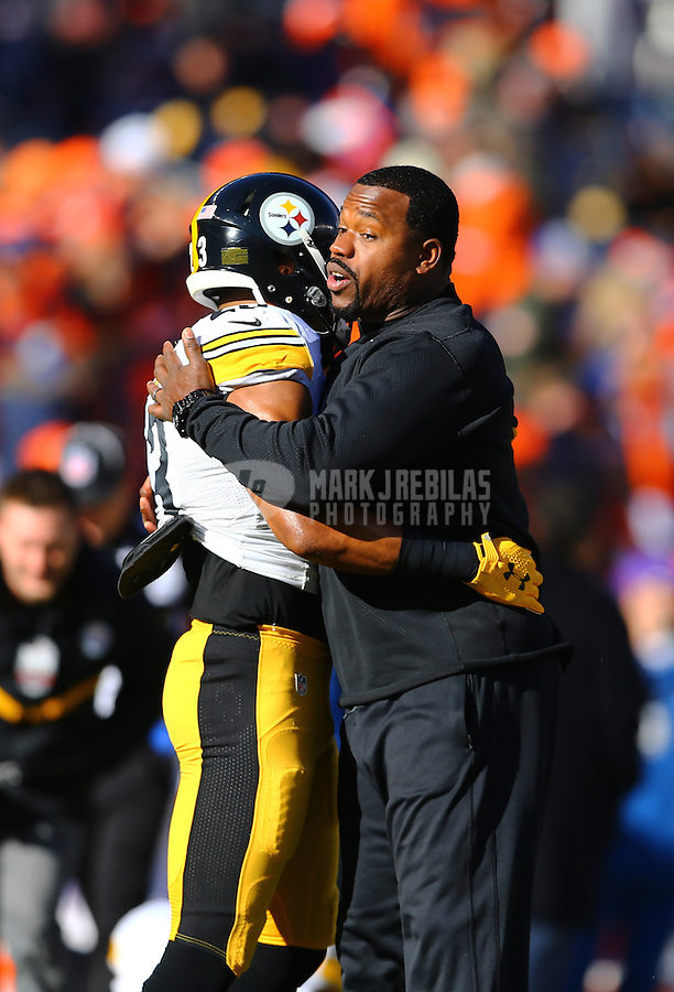 Jan 17, 2016; Denver, CO, USA; Pittsburgh Steelers safety Mike Mitchell (23) hugs outside linebackers coach Joey Porter against the Denver Broncos during the AFC Divisional round playoff game at Sports Authority Field at Mile High. Mandatory Credit: Mark J. Rebilas-USA TODAY Sports