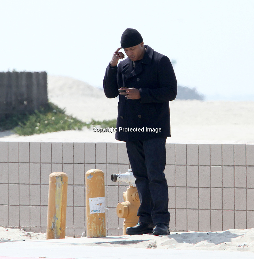 ...April 19th 2011 Exclusive ..LL Cool J goofing around laughing smiling & giving everyone on set back massages rubbing the backs & shoulders of just about every cast & crew member on set. LL was eating donuts drinking soda on the set of NCIS LA in Long Beach California. LL also was text messaging on his cell phone..Chris O'Donnell was riding his bicycle around on set while eating a hamburger. Daniela Ruah & Eric Christian Olsen joked around riding the bike together. ..AbilityFilms@yahoo.com.805-427-3519.www.AbilityFilms.com..