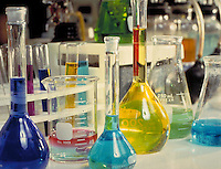 Chemistry lab with beakers, flasks, and test tubes full of colored fluid. biology, equipment, laboratory.