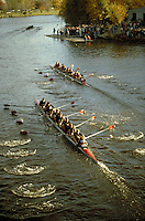 Three nine man crews race at the Head of the Charles Regatta.  boats, sports,. Cambridge Massachusetts.
