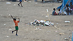 A young survivor of the January 12 earthquake in Haiti flies a kite at the edge of one of the many displaced settlements that have been established in empty fields and parks throughout Port-au-Prince. While aid is beginning to flow into the ravaged Caribbean nation, the future of these families remains unclear.
