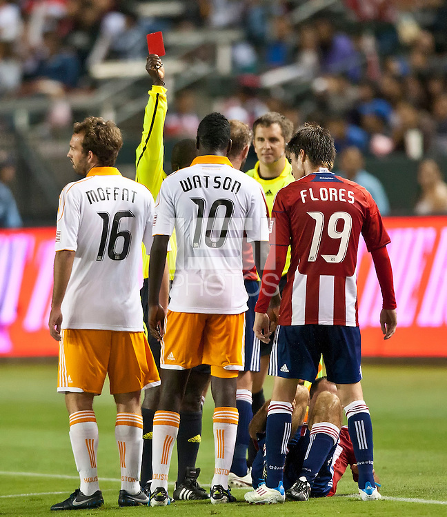 CARSON, CA – July 23, 2011: Houston Dynamo midfielder Je-Vaughn Watson (10) receives a red card during the match between Chivas USA and Houston Dynamo at the Home Depot Center in Carson, California. Final score Chivas USA 3, Houston Dynamo 0.