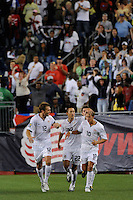Stuart Holden (10)  of the United States (USA) celebrates the game tying goal with Jimmy Conrad (12) and Davy Arnaud (22). The United States and Haiti played to a 2-2 tie during a CONCACAF Gold Cup Group B group stage match at Gillette Stadium in Foxborough, MA, on July 11, 2009. .