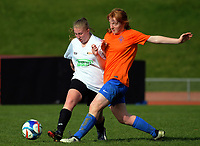 Action from the Women's Capital Premier football match between Wellington United Sapphires and Upper Hutt City (white) at Newtown Park in Wellington, New Zealand on Sunday, 23 July 2017. Photo: Dave Lintott / lintottphoto.co.nz