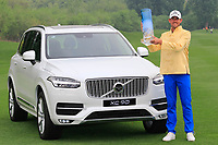 Alexander Bj&ouml;rk (SWE) poses with the trophy next to the Volvo XC90 car  after the final round of the Volvo China Open played at Topwin Golf and Country Club, Huairou, Beijing, China 26-29 April 2018.<br /> 29/04/2018.<br /> Picture: Golffile | Phil Inglis<br /> <br /> <br /> All photo usage must carry mandatory copyright credit (&copy; Golffile | Phil Inglis)