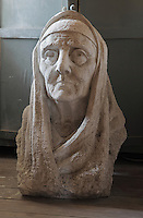 Bust of Mother Teresa, 1910-97, Albanian born nun and missionary, in the Gjirokastra Ethnographic Museum, on the site of the childhood home of Enver Hoxha, Albania's communist dictator 1944-85, Gjirokastra, Albania. The museum building was constructed in 1966 after the original house was destroyed by fire. Gjirokastra was settled by the Greek Chaonians, the Romans and Byzantines before becoming an Ottoman city in 1417. Its old town was listed as a UNESCO World Heritage Site in 2005. Picture by Manuel Cohen