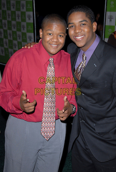 CHRIS MASSEY & KYLE MASSEY.16th Annual Environmental Media Association Awards Gala held at the Wilshire Ebell Theatre,Los Angeles, California, USA..November 8th, 2006.Ref: ADM/CH.half length blue suit jacket pink shirt pointing.www.capitalpictures.com.sales@capitalpictures.com.©AdMedia/Capital Pictures. *** Local Caption *** ..