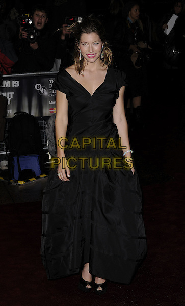 "JESSICA BIEL .At the UK film premiere of ""Easy Virtue"" during the BFI 52nd London Film Festival, London, England, .October 28th 2008. .LFF full length black dress gown long maxi platform shoes heels off the shoulder .CAP/CAN.©Can Nguyen/Capital Pictures."