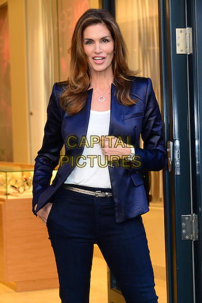 Cindy Crawford, Omeag brand ambassador cuts the ribbon at OMEGA's new Oxford Street flagship boutique to mark the store's opening. <br /> CAP/JOR<br /> &copy;JOR/Capital Pictures