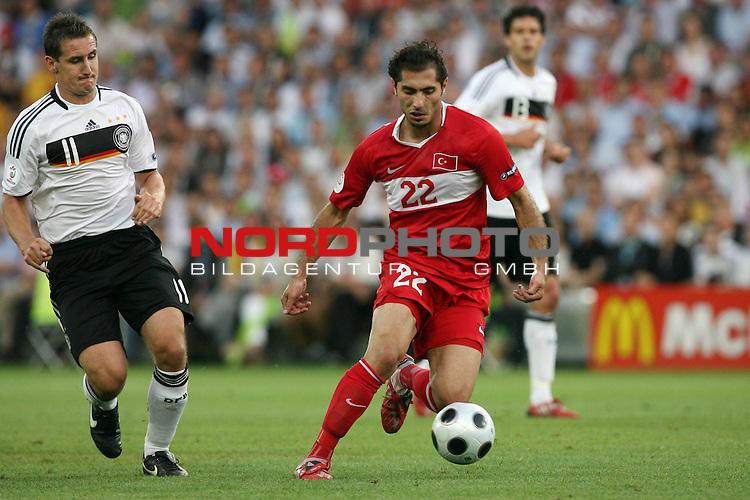 UEFA Euro 2008 Semi-Finals Match 29 Basel - St. Jakob-Park. Deutschland ( GER ) - T&uuml;rkei ( TUR ) 3:2 ( 1:1 ). <br /> Miroslav Klose ( Germany / Angreifer / Forward / Bayern Muenchen #11 ) (l) im Kampf um den Ball mit Hamit Altintop ( T&uuml;rkei / Mittelfeldspieler / Midfielder / FC Bayern M&uuml;nchen #22 ) (r).<br /> Foto &copy; nph (  nordphoto  )
