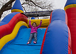 Four-year old Charli goes down the slide during the Community Easter Egg Dash at Idlewild Park in Reno, Nevada on Saturday, March 31, 2018.
