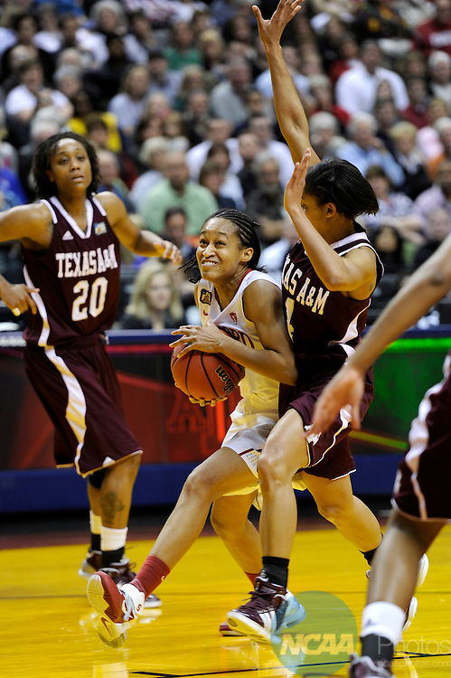 03 APR 2011:  Melanie Murphy (middle) of Stanford University drives to the goal against Texas A&M guard Sydney Carter during the Division I Women's Basketball Semifinals held at Conseco Fieldhouse in Indianapolis, IN.  Texas A&M defeated Stanford by a score of 63-62 to advance to the National Championship game.  Stephen Nowland/NCAA Photos