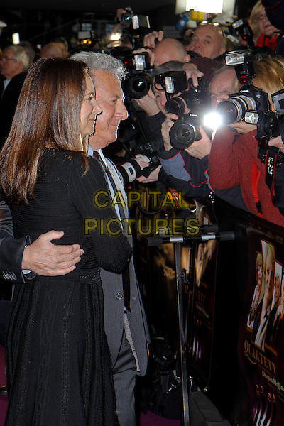 "Lisa Gottsegen & Dustin Hoffman.Premiere of ""Quartet"" in the German Opera Berlin, Germany..January 20th, 2013.half length black dress grey gray suit blue shirt red tie married husband wife side profile cameras photographers press.CAP/UNT.©Unit2/Capital Pictures"