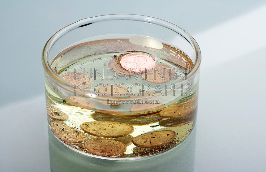 SCRATCHED PENNIES IN HYDROCHLORIC ACID<br /> (Variations Available)<br /> One Penny Floats<br /> Pre-1982 pennies were minted from a copper alloy of 5% zinc. After 1984 pennies were copper-coated zinc. The scratches exposed  the zinc disk to the HCl, reacting to form zinc chloride &amp; hydrogen gas. The thin copper shell floated to the top.