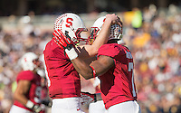 Stanford, California, 11-23-2013- Stanford's Kevin Hogan and Ty Montgomery during the 116th Big Game at Stanford Stadium on Saturday in Stanford, CA.