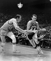 Los Angles Lakers Jerry West, past San Francisco Warriors Jeff Mullins, (1969 photo/Ron Riesterer)