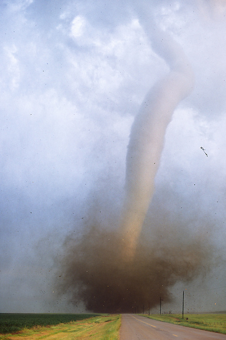 A violent tornado blocks passage down a road near Manchester South Dakota on June 24th, 2003. This storm was part of the largest single-day outbreak of tornadoes in the state's history.