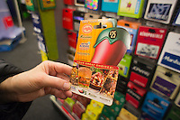 A combination Chili's, Romano's Macaroni Grill, On The Border and Maggiano's Little Italy restaurant gift cards in a store in New York on Wednesday, December 28, 2011.  Spending on gift cards totaled 18 percent of holiday spending this year, the highest amount since 2006. (© Richard B. Levine)
