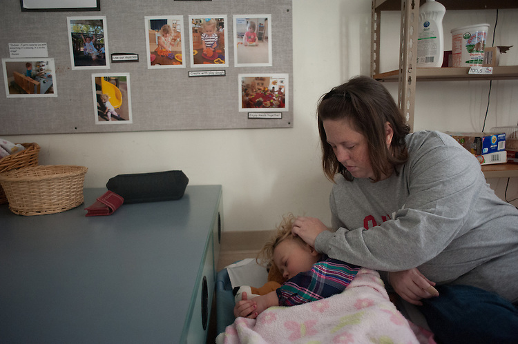Dana Parsely helps Maralee Antle fall asleep during naptime. © Ohio University / Photo by Ross Brinkerhoff