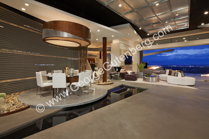 "Stock photo of ultra modern dining room ""floating"" on water feature"