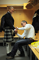 Pictured: Jazz Richards (L) is trying on a welsh kilt made by Tony Collins of the welsh tartan centre (R) at the Liberty Stadium, Swansea south Wales. Thursday 02 december 2011<br />