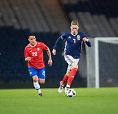 23rd March 2018, Hampden Park, Glasgow, Scotland; International Football Friendly, Scotland versus Costa Rica; Scott McTominay of Scotland races away from David Guzman of Costa Rica