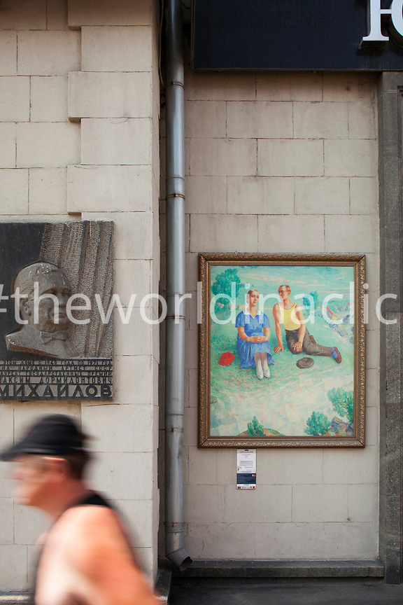 RUSSIA, Moscow. Paintings on display along a street in the city center.