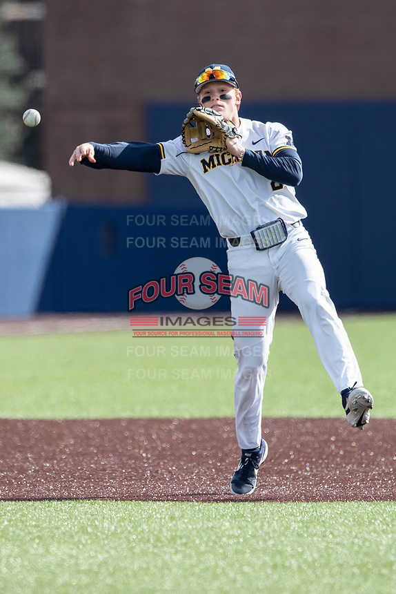 Michigan Wolverines shortstop Jack Blomgren (2) makes a throw to first base against the Western Michigan Broncos on March 18, 2019 in the NCAA baseball game at Ray Fisher Stadium in Ann Arbor, Michigan. Michigan defeated Western Michigan 12-5. (Andrew Woolley/Four Seam Images)