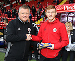 Chris Wilder manager of Sheffield Utd presents Shea Gordon with his U19 Irish football cap during the English League One match at Bramall Lane Stadium, Sheffield. Picture date: December 10th, 2016. Pic Simon Bellis/Sportimage