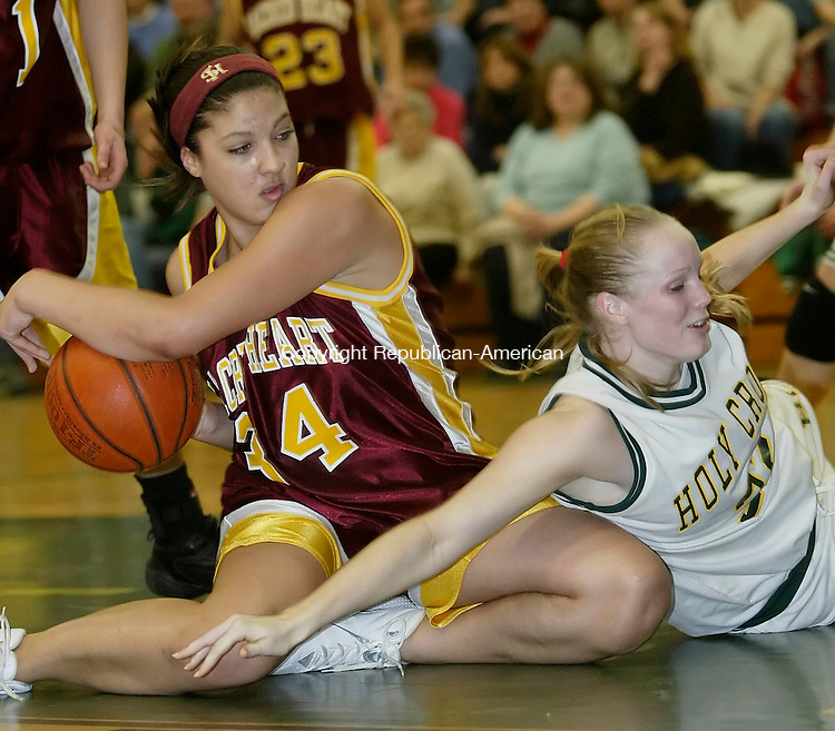 WATERBURY, CT. 13 JANUARY 2006-011306BZ07- Sacred Heart #34, Arielle Bailey comes up with the loose ball against Holy Cross #32, Christine Card<br /> during their game at Holy Cross Friday night. <br />  Jamison C. Bazinet / Republican-American