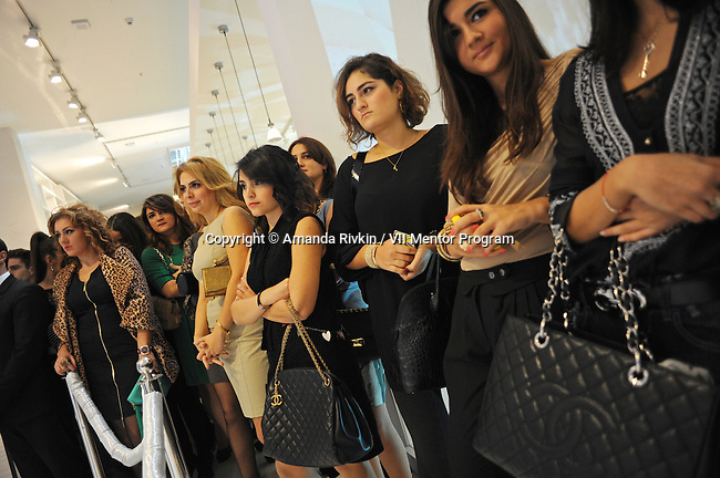 Young women watch a presentation at the grand opening celebration of Emporium's second store at the Port Baku luxury residences in the Azeri capital of Baku, Azerbaijan on October 28, 2011. Emporium's second store in Baku was designed by Japanese architect Yukio Ishiyama of the Milanese design firm Garde and features over 150 luxury ready-to-wear brands such as Azzedine Alaïa, Marc Jacobs and Stella McCartney; Emporium is widely considered to offer the greatest variety of high-end designer shopping in Baku under one roof.