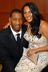 Clerenda and Tracy McGrady at the Houston Rockets Tux & Tennies benefit at Toyota Center Thursday March  27,2008. (Dave Rossman/For the Chronicle)